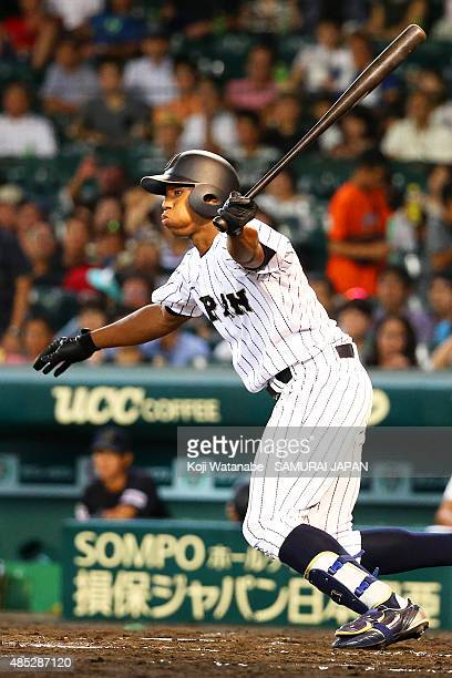 Outfielder Louis Okoye of Japan hits a single in the bottom half of the third inning in the sendoff game between U18 Japan and Collegiate Japan...