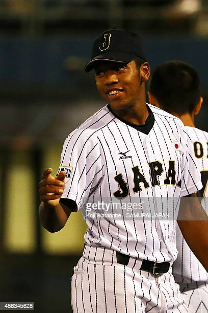 Outfielder Louis Okoye of Japan looks on in the super round game between Japan v Canada during the 2015 WBSC U-18 Baseball World Cup at the Maishima...