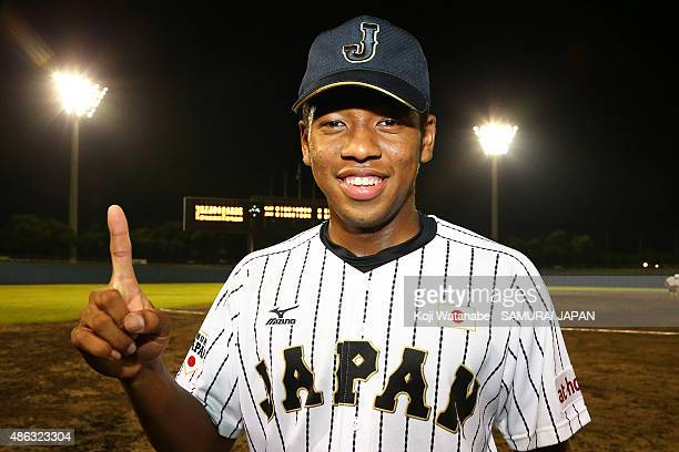 Outfielder Louis Okoye of Japan poses for a photograph after winning in the super round game between Japan v Canada during the 2015 WBSC U-18...