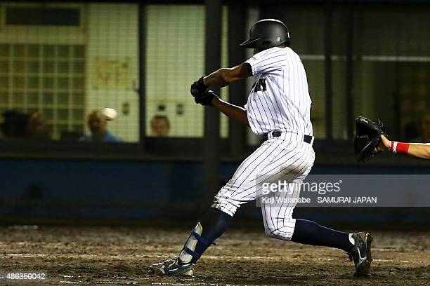 Outfielder Louis Okoye of Japan two-run single in the bottom half of the third inning in the super round game between Japan v Canada during the 2015...