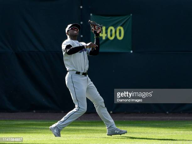Outfielder Luis Robert of the Winston-Salem Dash, single-A affiliate of the Chicago White Sox, catches a ball hit by outfielder Armond Upshaw of the...