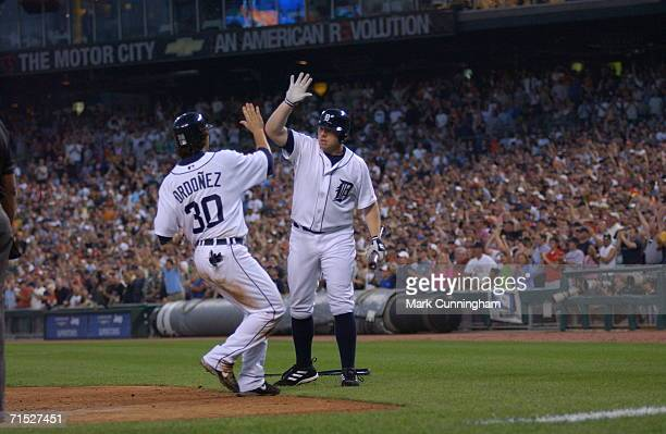 Outfielder Magglio Ordonez of the Detroit Tigers is greeted at home by Chris Shelton after scoring a run on June 27 2006 as the Detroit Tigers defeat...