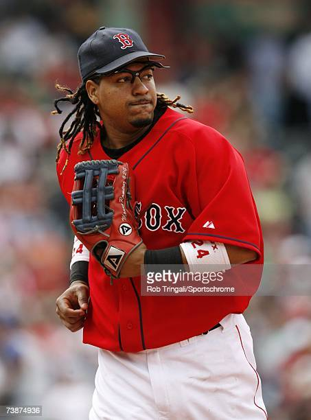 Outfielder Manny Ramirez of the Boston Red Sox looks on against the Texas Rangers on June 11 2006 at at Fenway Park in Boston Massachusetts