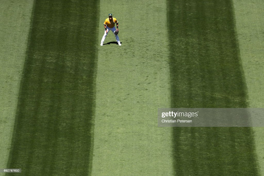 Outfielder Mark Canha #20 of the Oakland Athletics in action during the MLB game against the Washington Nationals at Oakland Coliseum on June 3, 2017 in Oakland, California. The Athletics defeated the Nationals 10-4.