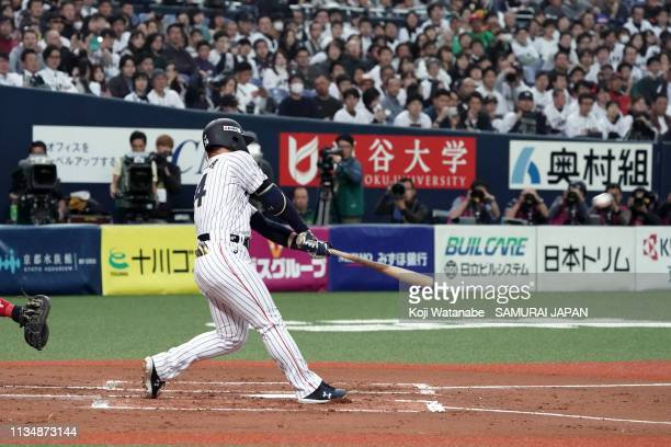 Outfielder Masataka Yoshida of Japan hits a grand slam to make it 04 in the bottom of the 1st inning during the game two between Japan and Mexico at...