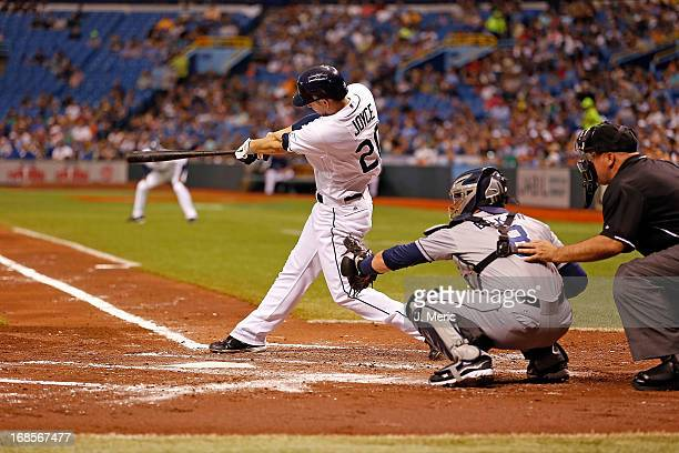 Outfielder Matt Joyce of the Tampa Bay Rays doubles in the second inning against the San Diego Padres at Tropicana Field on May 11 2013 in St...