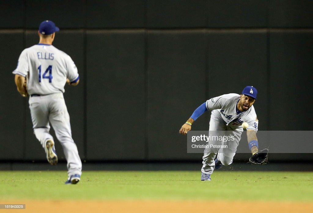 Outfielder Matt Kemp #27 of the Los Angeles Dodgers makes a diving catch on a ball hit by Aaron Hill (not pictured) of the Arizona Diamondbacks during the MLB game at Chase Field on September 12, 2012 in Phoenix, Arizona.