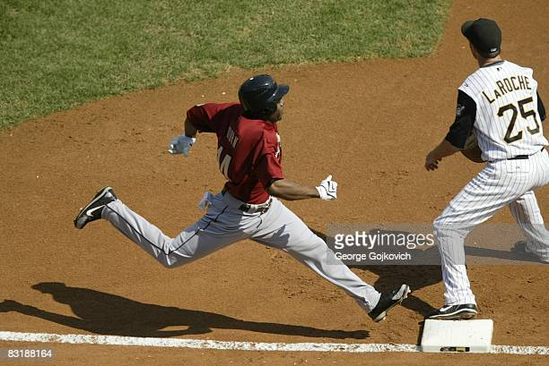 Outfielder Michael Bourn of the Houston Astros reaches first base for a single before the ball reaches first baseman Adam LaRoche of the Pittsburgh...