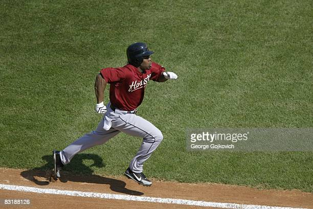 Outfielder Michael Bourn of the Houston Astros runs to first base after batting against the Pittsburgh Pirates during a game at PNC Park on September...