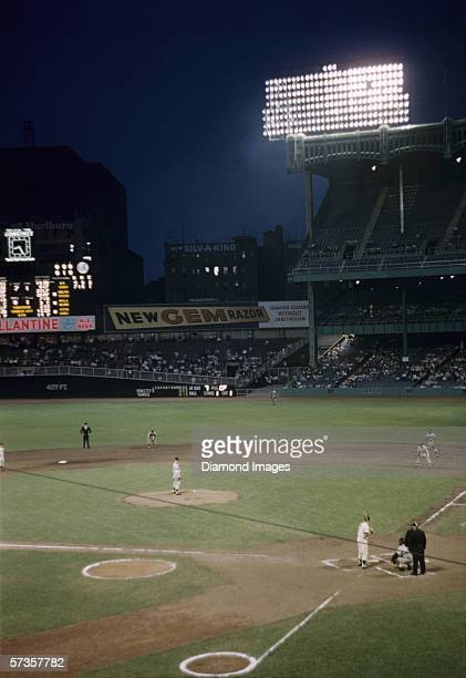 Outfielder Mickey Mantle of the New York Yankees at bat during the bottom of the first inning a game against the Kansas City A's on July 20 1956 at...