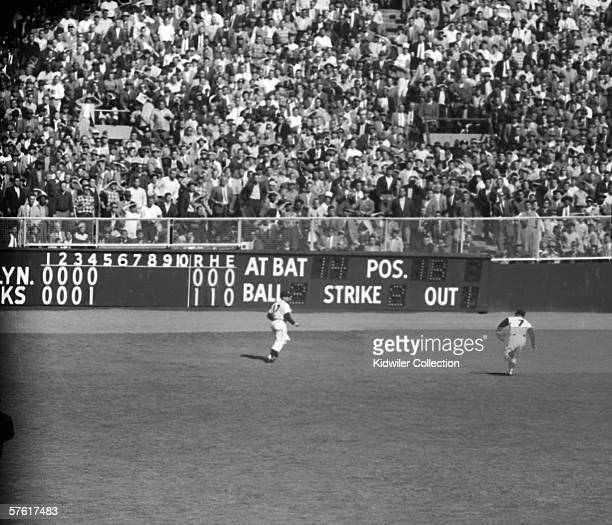 Outfielder Mickey Mantle of the New York Yankees runs down the deep flyball hit by Gil Hodges of the Brooklyn Dodgers during the fifth inning of the...