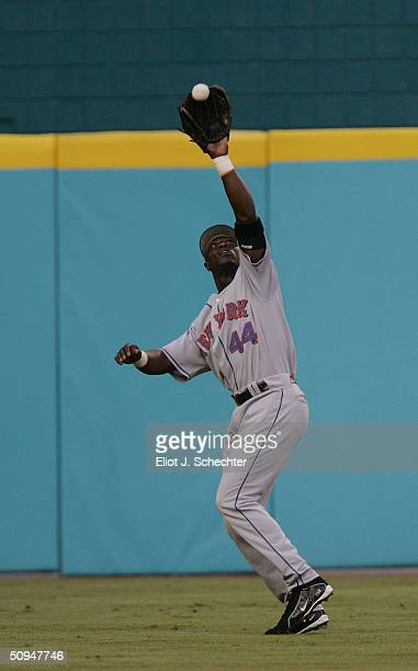Outfielder Mike Cameron of the New York Mets catches the ball against the Florida Marlins at Pro Player Stadium on May 29, 2004 in Miami Florida. The...