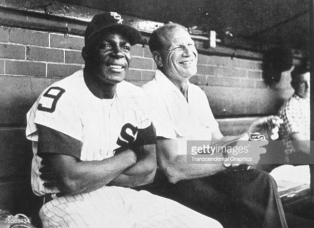Outfielder Minnie Minoso left and owner Bill Veeck of the Chicago White Sox enjoy a laugh in the Comiskey Park dugout in 1957