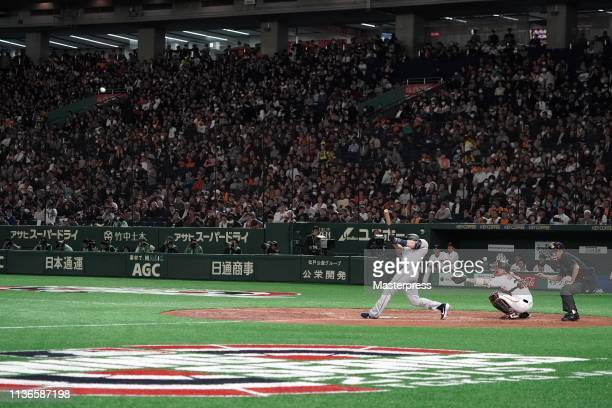 Outfielder Mitch Haniger hits a two-run homer to make it 5-5 in the top of 7th inning during the preseason friendly game between Yomiuri Giants and...