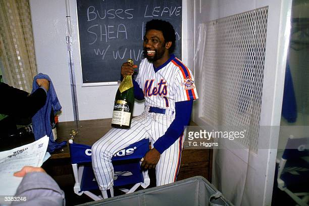 Outfielder Mookie Wilson of the New York Mets celebrates with a bottle of champagne after winning game 7 of the 1986 World Series against the Boston...