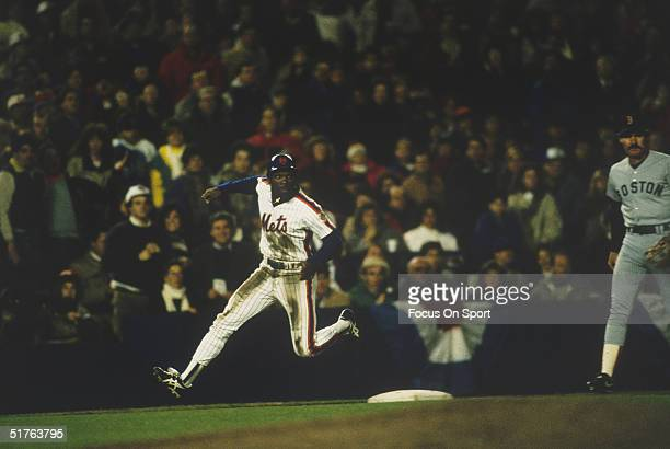 Outfielder Mookie Wilson of the New York Mets rounds third base during the World Series against the Boston Red Sox at Shea Stadium on October 1986 in...
