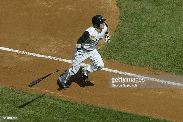 Outfielder Nate McLouth of the Pittsburgh Pirates drops his bat as he runs to first base after batting against the Houston Astros during a game at...