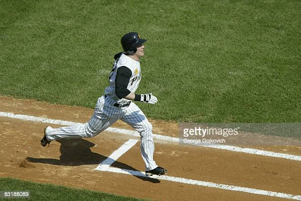 Outfielder Nate McLouth of the Pittsburgh Pirates runs to first base after batting against the Houston Astros during a game at PNC Park on September...
