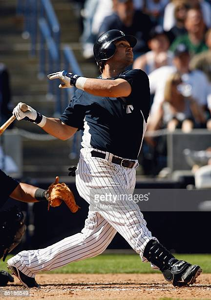 Outfielder Nick Swisher of the New York Yankees fouls off a pitch against the Minnesota Twins during a Grapefruit League Spring Training game at...