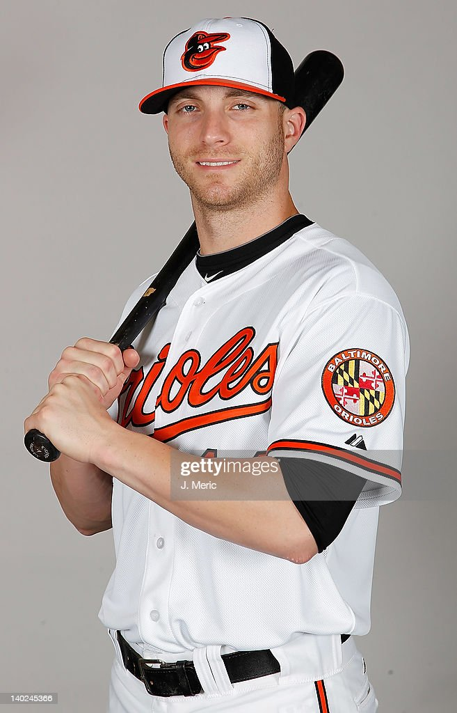 Outfielder Nolan Reimold #14 of the Baltimore Orioles poses for a photo during photo day at Ed Smith Stadium on March 1, 2011 in Sarasota, Florida.