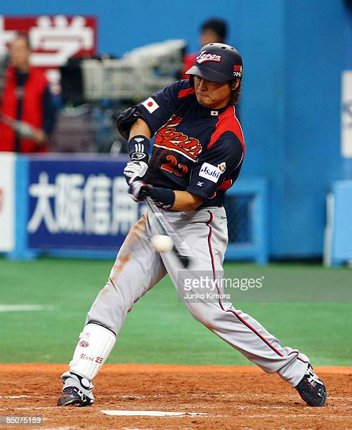 Outfielder Norichika Aoki of Japan hits a triple in the fourth inning of an exhibition match between Japan and Australia at Kyocera Dome Osaka on...