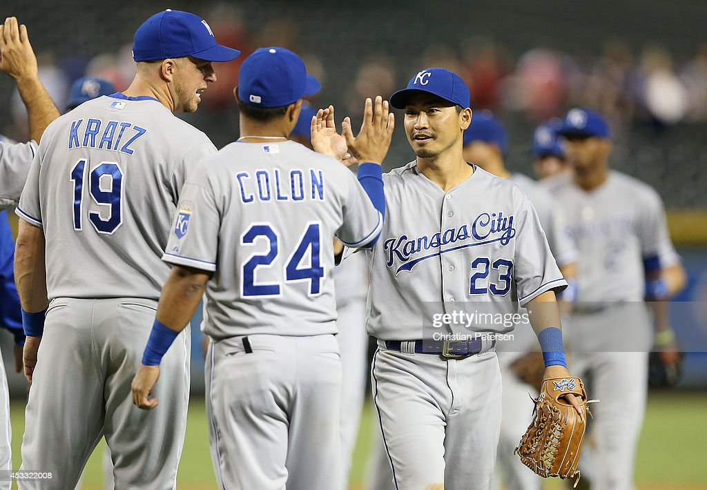 Outfielder Norichika Aoki #23 of the Kansas City Royals celebrates with Christian Colon #24 after defeating the Arizona Diamondbacks 6-2 in the MLB game at Chase Field on August 7, 2014 in Phoenix, Arizona.
