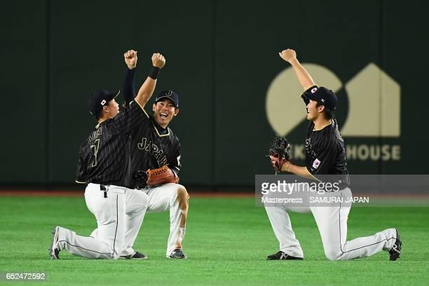 Outfielder Norichika Aoki, Outfielder Shogo Akiyama and Outfielder Seiya Suzuki of Japan celebrate their 8-6 victory after the World Baseball Classic...