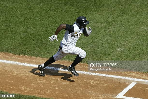 Outfielder Nyjer Morgan of the Pittsburgh Pirates runs to first base after batting against the Houston Astros during a game at PNC Park on September...