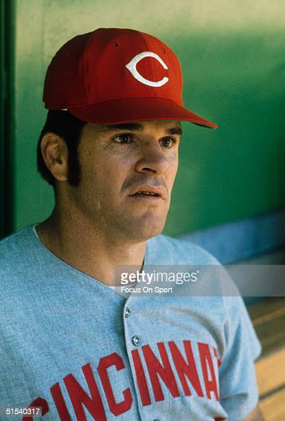 Outfielder Pete Rose of the Cincinnati Reds looks on in the visitor's dugout during a game against the Phillies at Veterans Stadium during the 1970s...