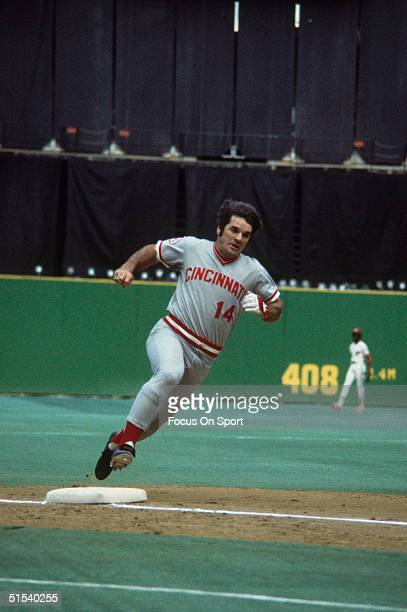 Outfielder Pete Rose of the Cincinnati Reds motors around third base and heads for home plate at Veterans Stadium during the 1970s in Philadelphia...