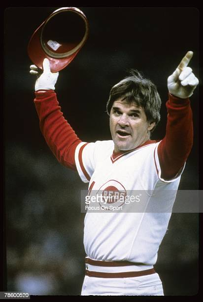 Outfielder Pete Rose of the Cincinnati Reds salutes the crowd after surpassing Ty Cobb with his 4192 hit that came against San Diego Padres pitcher...