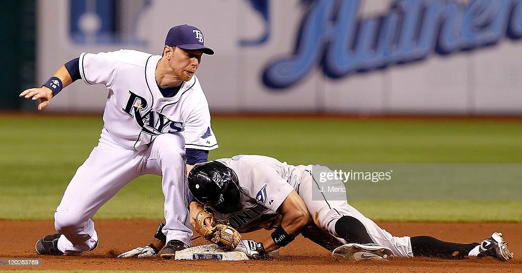 Outfielder Rajai Davis #11 of the Toronto Blue Jays doubles as infielder Ben Zobrist #18 of the Tampa Bay Rays is late with the tag during the game at Tropicana Field on August 2, 2011 in St. Petersburg, Florida.