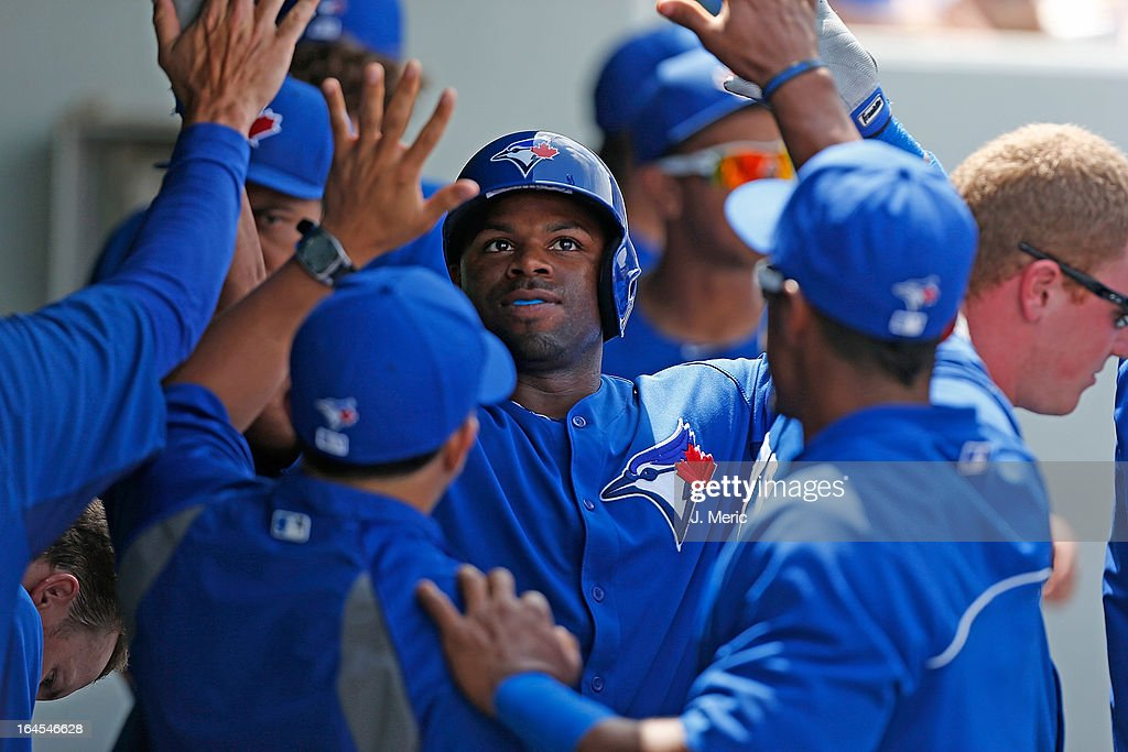 Outfielder Rajai Davis #11 of the Toronto Blue Jays is congratulated after his home run against the Minnesota Twins during a Grapefruit League Spring Training Game at Hammond Stadium on March 24, 2013 in Fort Myers, Florida.