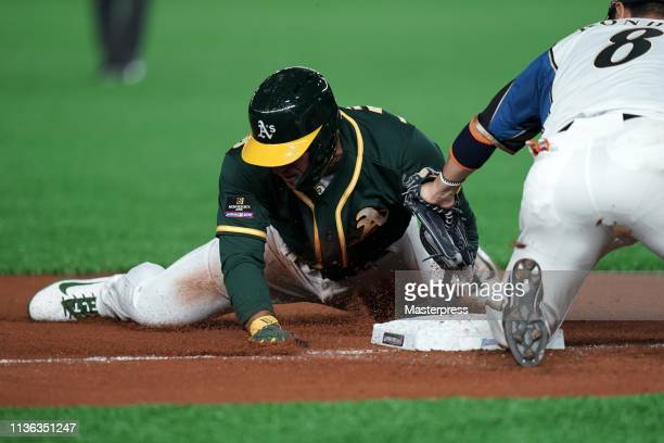 Outfielder Ramon Laureano of the Oakland Athletics is caught stealing the third base on the top of 2nd inning during the game between Hokkaido...