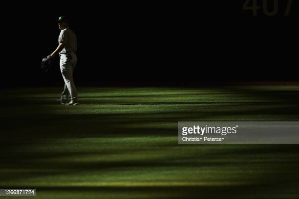 Outfielder Ramon Laureano of the Oakland Athletics warms-up before the MLB game against the Arizona Diamondbacks at Chase Field on August 17, 2020 in...