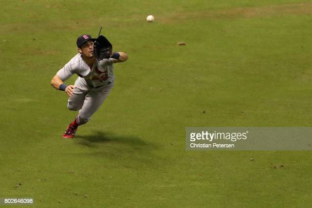 Outfielder Randal Grichuk of the St Louis Cardinals makes a diving catch against the Arizona Diamondbacks during the ninth inning of the MLB game at...