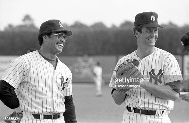 Outfielder Reggie Jackson and pitcher Tommy John of the New York Yankees laugh during Spring Training in March 1979 at Ft Lauderdale Stadium in Ft...