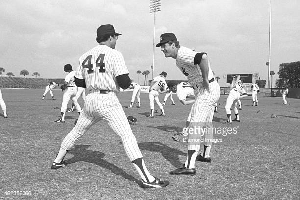 Outfielder Reggie Jackson and pitcher Tommy John of the New York Yankees stretches during Spring Training in March 1979 at Ft Lauderdale Stadium in...
