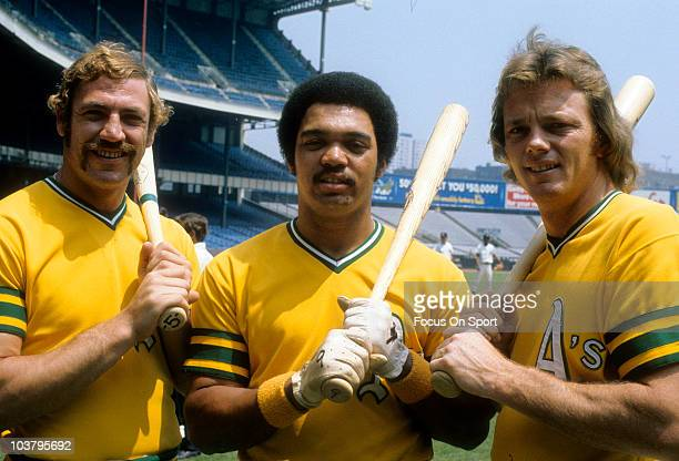 Outfielder Reggie Jackson catcher Dave Duncan and infielder Mike Epstein of the Oakland Athletics pose together during a Major League Baseball game...