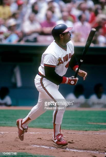 Outfielder Reggie Jackson of the Californian Angels swings and watches the flight of his ball during a Major League Baseball game circa 1986 at...