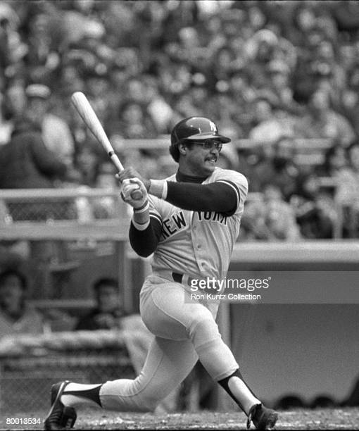 Outfielder Reggie Jackson of the New York Yankees at bat during a game on April 24 1977 against the Cleveland Indians at Municipal Stadium in...
