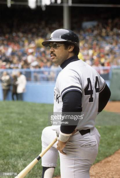 Outfielder Reggie Jackson of the New York Yankees kneels in the on deck circle during a game in May 1977 against the Cleveland Indians at Municipal...