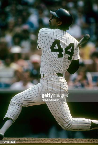 Outfielder Reggie Jackson of the New York Yankees swings and watches the flight of his ball during a Major League Baseball game circa 1981 at Yankee...
