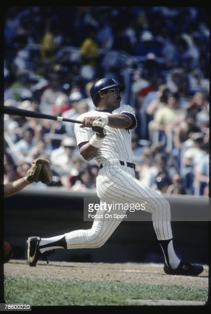 Outfielder Reggie Jackson of the New York Yankees swings and watches the flight of his ball during a circa late 1970s game at Yankee Stadium in Bronx...