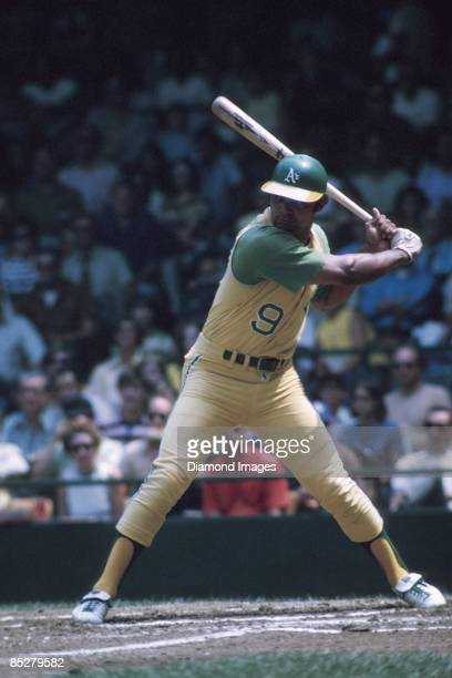 Outfielder Reggie Jackson of the Oakland A's swings at a pitch during a game in 1971 against the Detroit Tigers at Tiger Stadium in Detroit Michigan