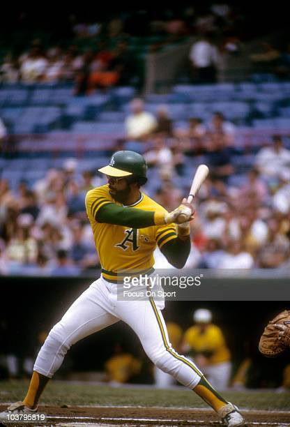 Outfielder Reggie Jackson of the Oakland Athletics ready to swing at a pitch against the Baltimore Orioles during a Major League Baseball game circa...