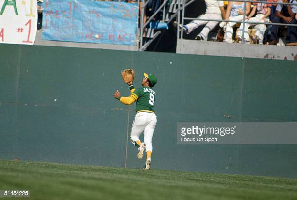 Outfielder Reggie Jackson of the Oakland Athletics rushes to catch the ball during the World Series against New York Mets at OaklandAlameda County...