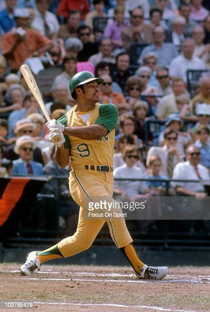Outfielder Reggie Jackson of the Oakland Athletics swings and misses the pitch against the Baltimore Orioles during a Major League Baseball game...