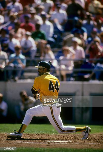 Outfielder Reggie Jackson of the Oakland Athletics swings and watches the flight of his ball during a spring training Major League Baseball game...