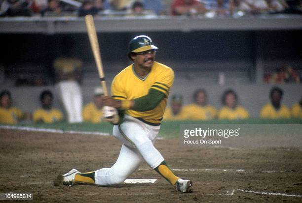 Outfielder Reggie Jackson of the Oakland Athletics swings at a pitch during a Major League Baseball game circa 1974 Jackson played for the Athletics...
